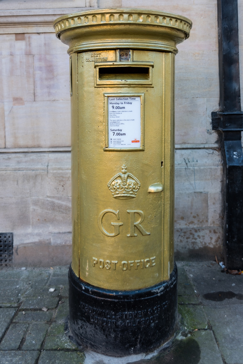 Gold post box, St Paul's Square, Bedford to achievement of Olympic gold medal winning canoeist Etienne Stott